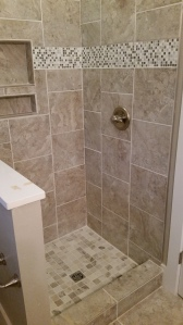 Upstairs bathroom tile shower
