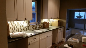 Highlands Kitchen with new cabinets, back splash, and island.